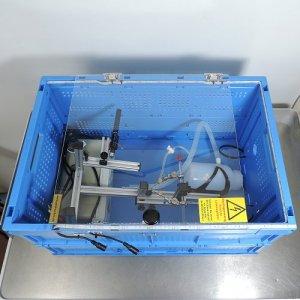 Schutzbox für Hochvolttrafo mit Zubehör und Trafo wegpacken